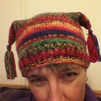 Handknitted tasselled hat