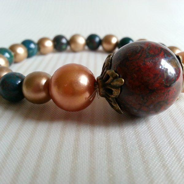 Beaded elasticated bracelet gold green and red