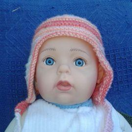Pink baby hat straps loose