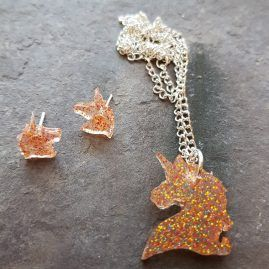 Golden sparks unicorn pendant and earring set.