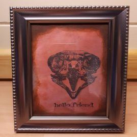 framed bird skull