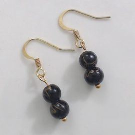 Two bead earring on gold coloured ear wire