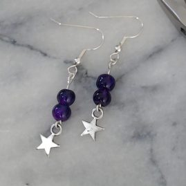 Two purple bead earrings with star